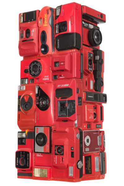 "Artwork named "" Red Eyes "" : Cybertrash totem sculpture by Rémy Tassou. One 3/4 view."