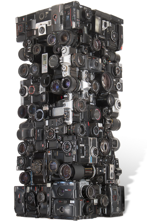"Artwork named "" NIKON "": Cybertrash totem sculpture by Rémy Tassou. One 3/4 view( Main view)"
