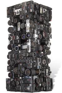 "Artwork named "" NIKON "": Cybertrash totem sculpture by Rémy Tassou. One 3/4 view. Main view (vignette)"